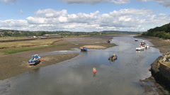 Boats on River Axe at Low Tide in Seaton Devon Stock Footage