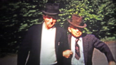 1953: Single men of the day wearing fedora hats and smoking. Stock Footage