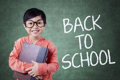 Smart little student and back to school text Stock Photos