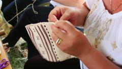 Woman doing needlework Stock Footage