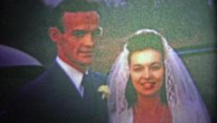 1954: Recently married couple walks into their new home, man smokes pipe. Stock Footage