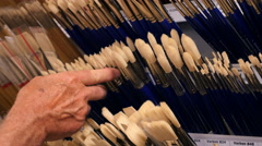 Paint brushes at art supplies store Stock Footage