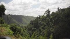 Thomson's Falls waterfalls vegetation, Kenya, Africa, long shot, pan right Stock Footage