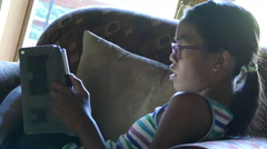 Teenage Asian Girl Using Her Tablet On The Sofa Stock Footage
