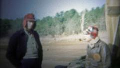 1956: Family getting ready for a trip, outside of the family fishing shack. Stock Footage