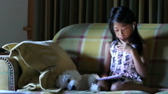 Cute Asian Girl Using Tablet On The Sofa Stock Footage