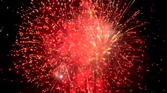 4K Exciting Sparkling Fireworks Celebration Splashes Color In Night Sky Stock Footage