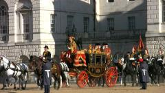 Queen Elizabeth and Prince Philip riding across Horse Guards Parade in London. Stock Footage
