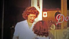 1953: Daughter and mother outside of a five and dime general store. Stock Footage