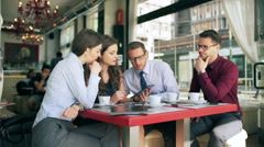 Businesspeople working together on tablet in the cafe Stock Footage