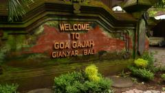Welcome to Goa Gajah inscription on brick wall, parallax shot Stock Footage