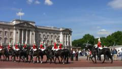 The Household Cavalry Mounted Regiment pass Buckingham Palace. Stock Footage