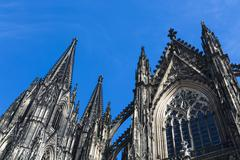 Cologne Cathedral low angle view from the side with blue sky Stock Photos