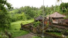 Small Balinese villa against mountain landscape, pan shot Stock Footage