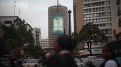 Hilton hotel and street with traffic and people, Nairobi, Kenya, Africa Stock Footage