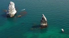 Rocks In The Blue Sea Camera High Stock Footage