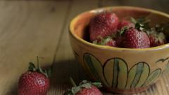Perfect ripe strawberries in a ceramic bowl for a healthy breakfast dolly shot - stock footage