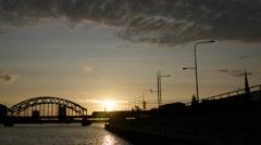 Stock Video Footage of The Railway Bridge during sunset in Riga Latvia