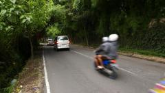 Busy traffic, rural road arched by trees tunnel, running vehicle noises Stock Footage