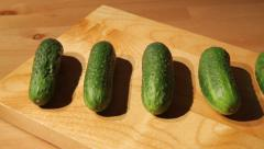 Stock Video Footage of Fresh cucumbers on a board