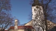 Bell Tower in white Church with winter tree in front - stock footage