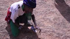 Tribal man sharpening his knife, Kenya, Africa Stock Footage