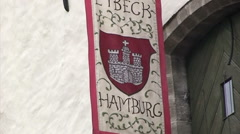 Medieval looking banner hanging on old building in Tallinn Stock Footage