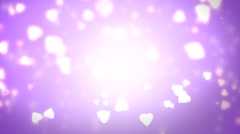 Violet background with hearts and bokeh elements on it - seamless loop. - stock footage