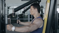 Muscular bodybuilder doing exercises workout in gym for pectoral muscles Stock Footage