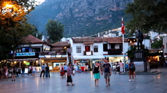 People on the square of Kas, Turkey in evening - stock footage