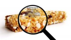 Nutrition facts on granola bar - stock footage