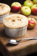 Individual Miniature Apple Pie with Spoon Stock Photos