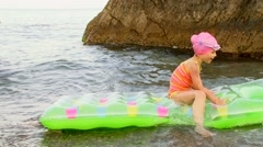 Child Floats On Mattresses In The Sea Stock Footage