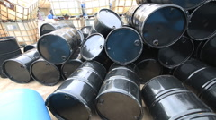 Several barrels at storage yard in refinery Plant Stock Footage