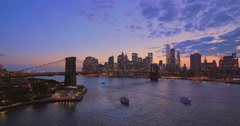 New York City Brooklyn Bridge downtown buildings skyline sunset evening - stock footage