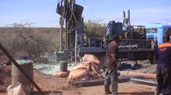 Drilling for water, borehole borewell in rural Africa, Kenya - stock footage