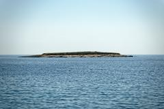 Scenic view of a small island - stock photo