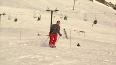 Fast skiing pass by camera Stock Footage