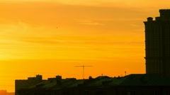 Sunset above the roofs of the city Stock Footage