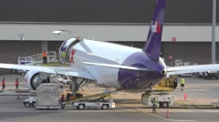 4K FedEx Boeing 767 cargo jet ground crew Stock Footage
