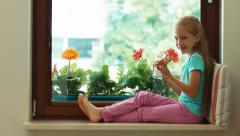 Girl drinking milk and holding sandwich with pate sitting on the windowsill Stock Footage