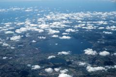 Outer view on land and clouds Stock Photos