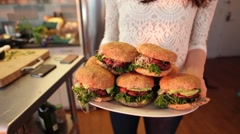Female Chef Presenting Organic Vegetarian Burgers Stock Video Stock Footage