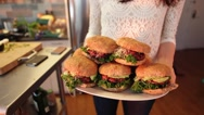 Stock Video Footage of Female Chef Presenting Organic Vegetarian Burgers Stock Video