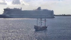Pirate ship next to cruise ship, Cayman Islands Stock Footage