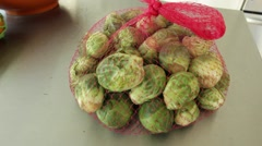 Bag of Brussel Sprouts on Counter Table Stock Video Stock Footage