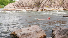 Adult man  bathes in the river. 4K 3840x2160 Stock Footage