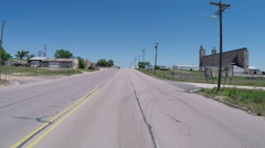 POV Driving Through Brownfield Texas Farming And Oil Town Stock Footage
