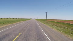 POV Driving West Texas Highway Past Grazing Cattle Stock Footage
