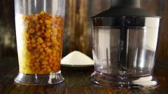 Blender with berries sea buckthorn Stock Footage